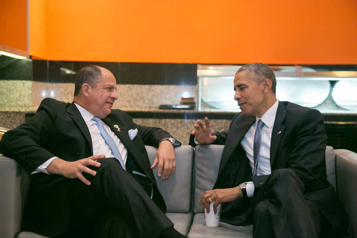 Costa Rica President Luis Guillermo Solís and U.S. President Barack Obama speak privately during the 2015 Summit of the Americas on Friday, April 10.