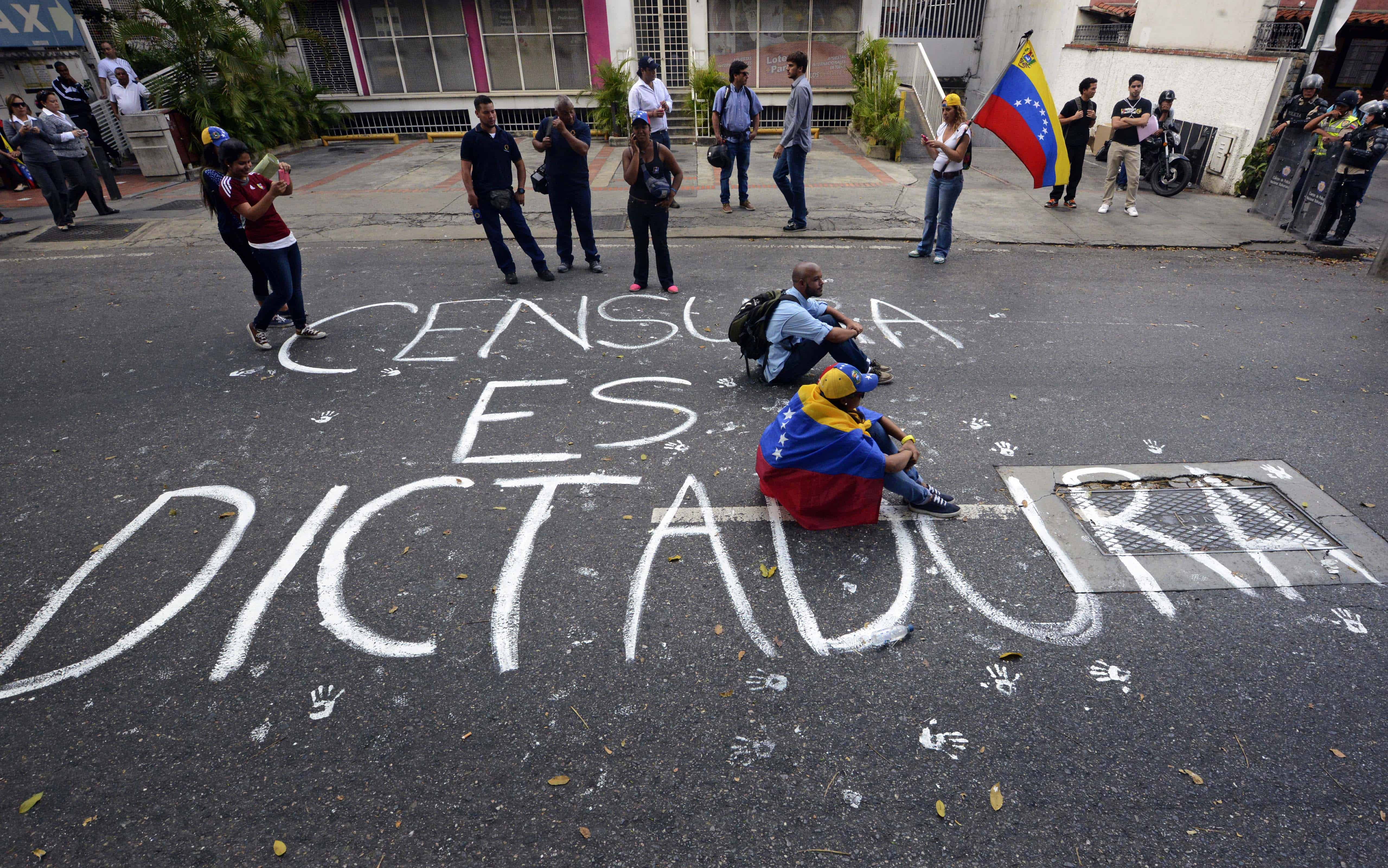 Students sit during an anti-government protest in Caracas on Feb. 17, 2014.