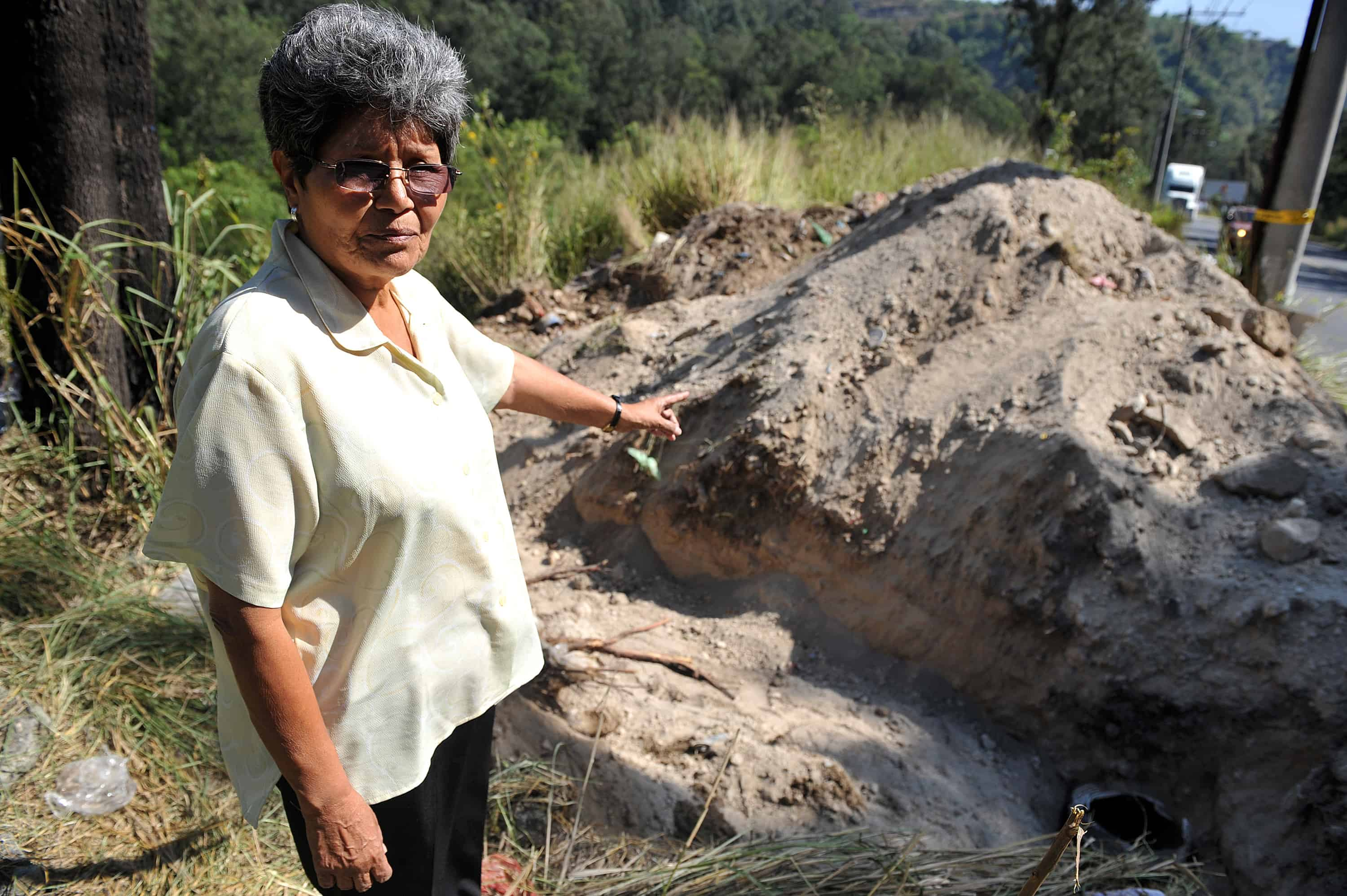Aura Elena Farfán signals to the area to be dug up in hopes of finding the remains of her late-brother, Rubén Amílcar Farfán, who was captured and went missing on May 15, 1984 during the Guatemalan Civil War (1960-1996), in Villa Lobos, 12 kilometers south of Guatemala City. Photo taken December 11, 2009.