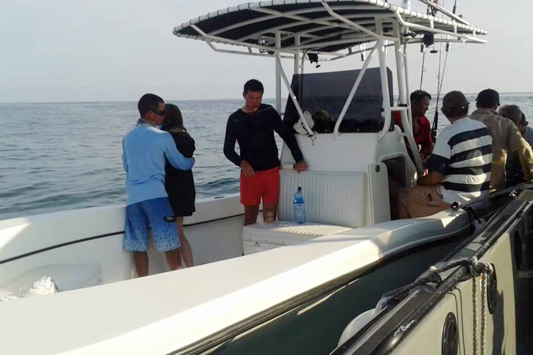 Coast Guard officials resuce passengers from a boat that sunk off of Golfito, April 19, 2014