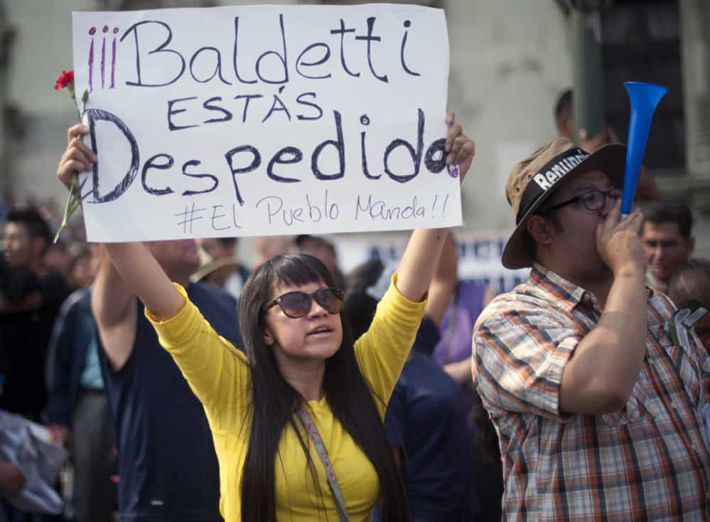 "A protestor holds a sign saying ""Baldetti you're fired"" during a protest in Guatemala City's central plaza, April 25, 2015."