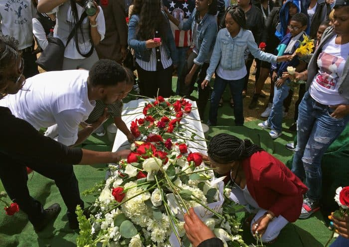 Friends and relatives lay flowers on Freddie Gray's casket.