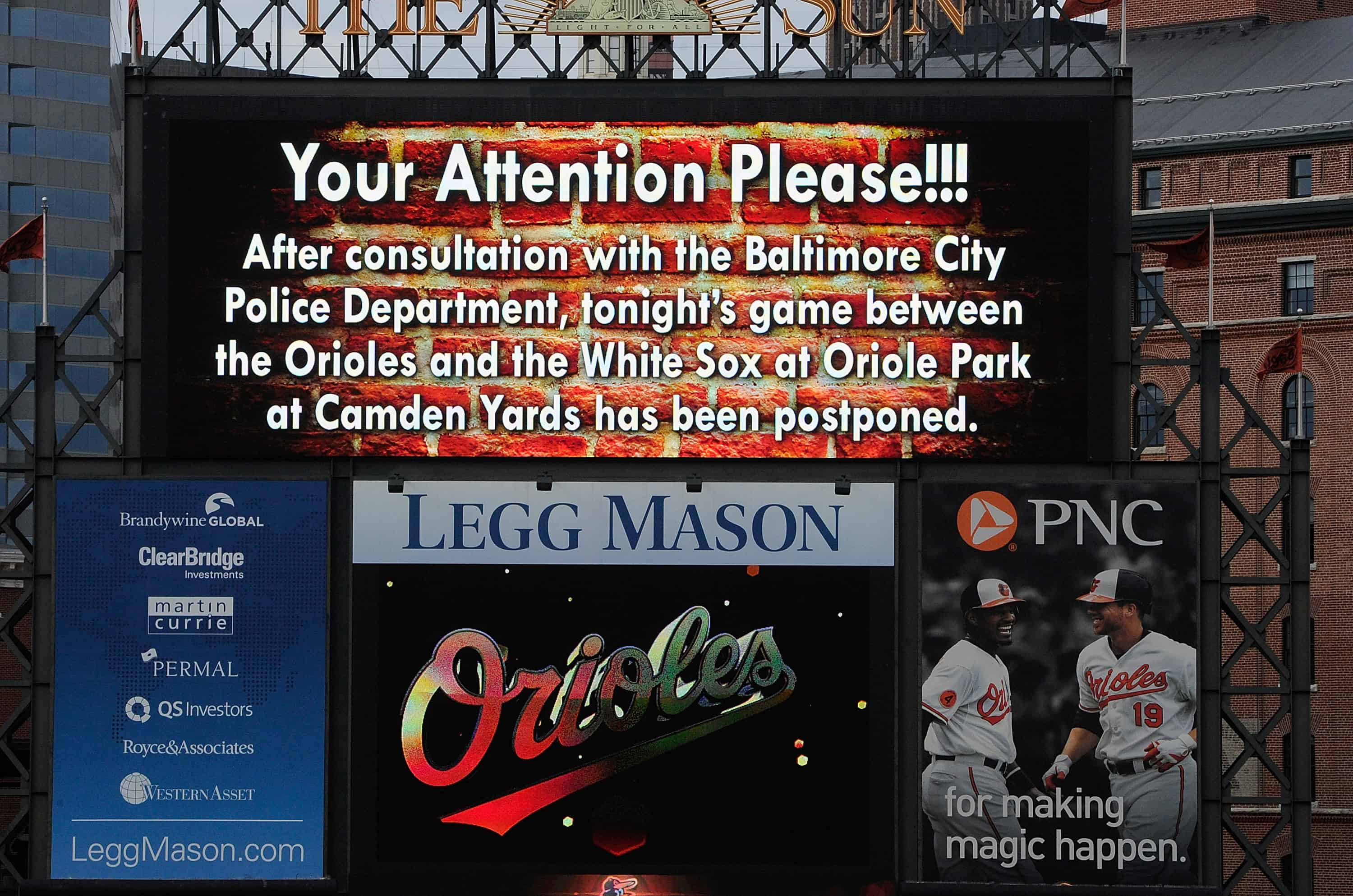 An announcement on the scoreboard notifies fans that the game between the Baltimore Orioles and the Chicago White Sox has been postponed at Oriole Park at Camden Yards.