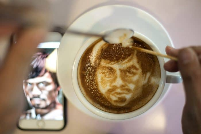 Barista Zach Yonzon uses coffee latte milk froth to illustrate Philippine boxing icon Manny Pacquiao.