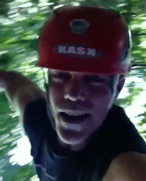 A still from a video, upside down on a Tarzan swing.