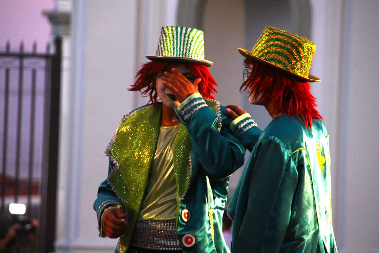 Sad clown: Buskers perform at FIA's opening ceremony in Alajuelita.