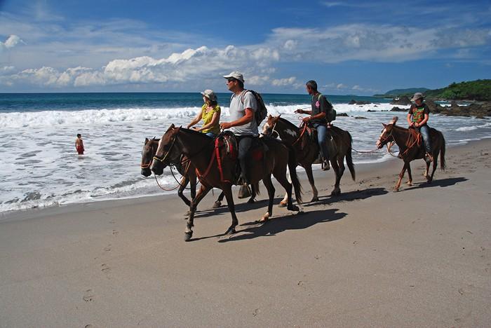 Horseback riding on the beach  in Montezuma, Guanacaste.