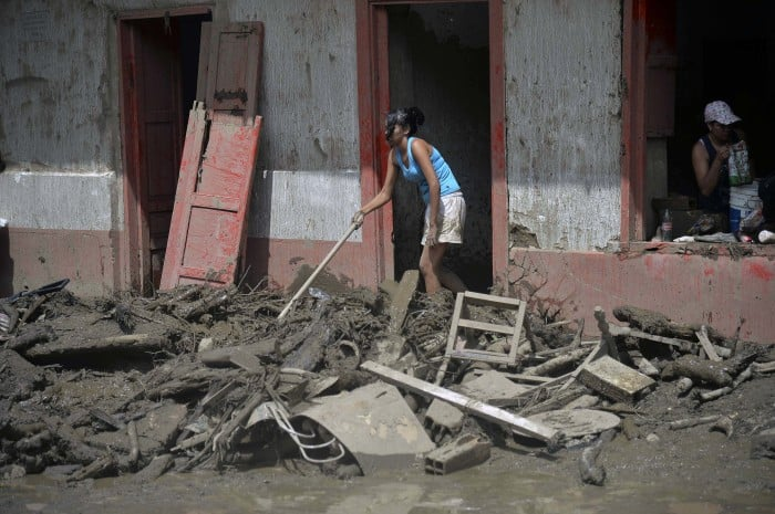 Residents clean a home after a landslide in Salgar municipality, Antioquia, Colombia on May 18, 2015.