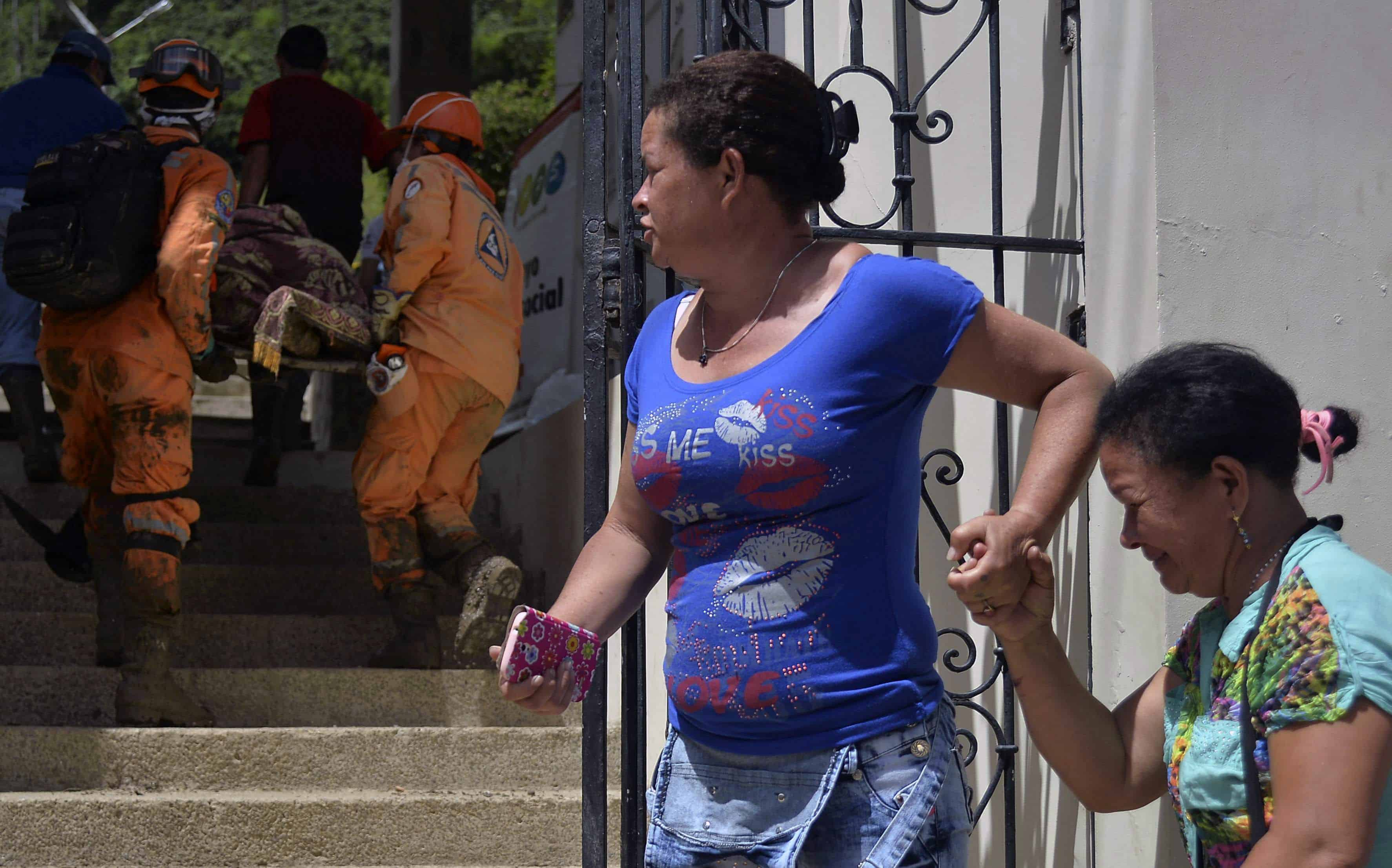 Women react as rescue workers carry a corpse after a landslide in Salgar Municipality, Antioquia, Colombia.