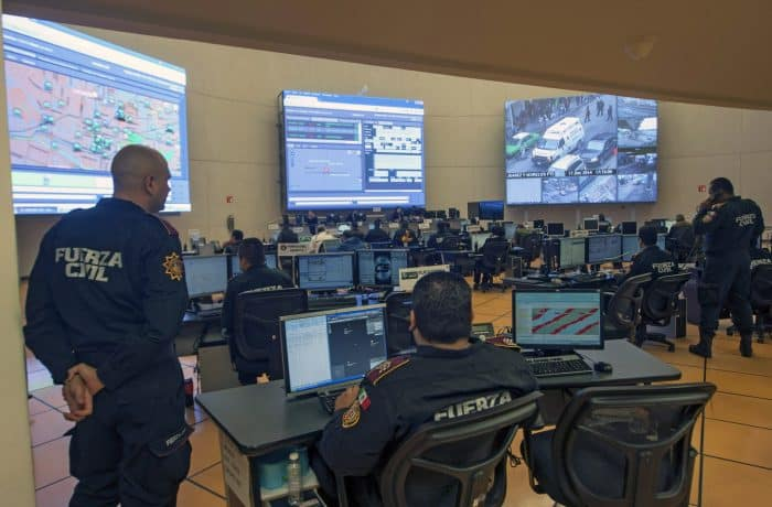 Members of the Civil Police Force watch screens at the Integral Coordination Center of Control, Command, Communications and State Count (C-5).