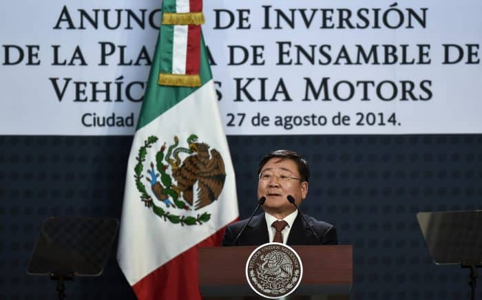 The vice president of global strategy at Kia Motors, Hyung-Kun Lee, delivers a speech during an announcement in Mexico City.