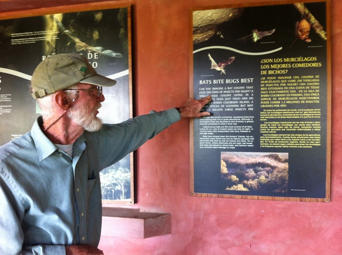 Richard LaVal points to an exhibit that mentions a bat colony that eats 250 tons of insects per night.