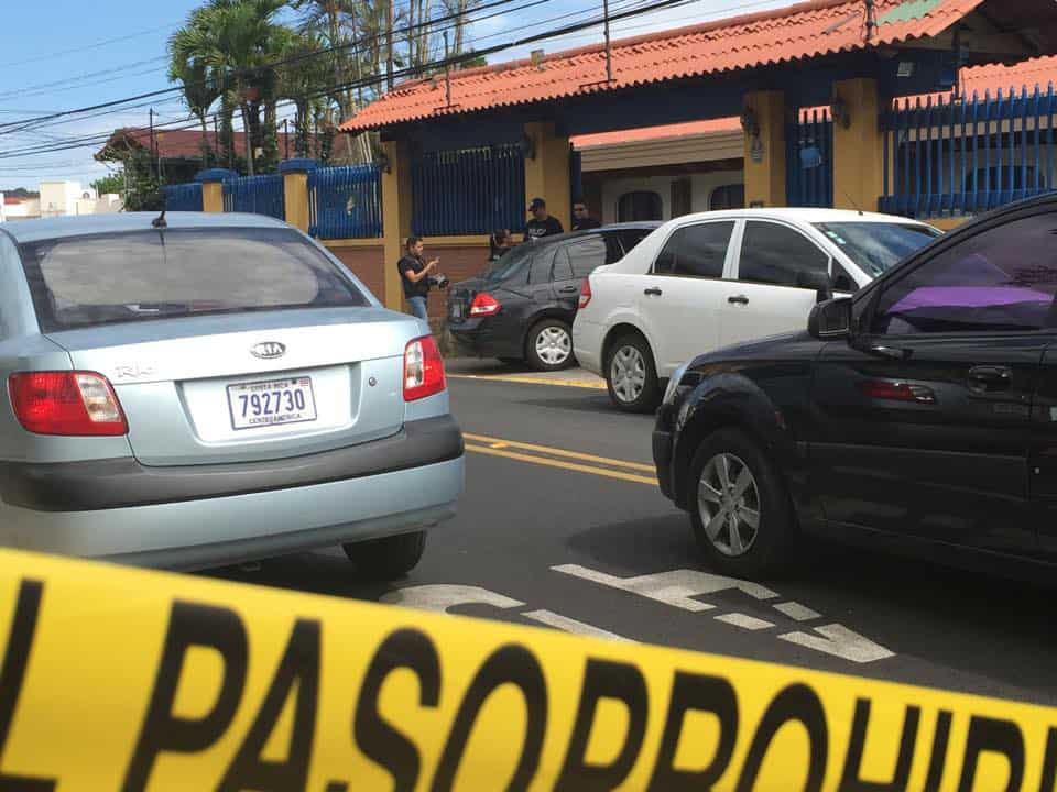 Police raid a senior center in downtown Escazú May 20, 2015, in response to complaint of abuse at the facility.