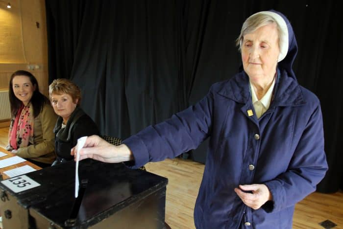 Sister Loreto Ryan of the Sisters of Charity casts her vote at a polling station in Drumcondra, north Dublin.