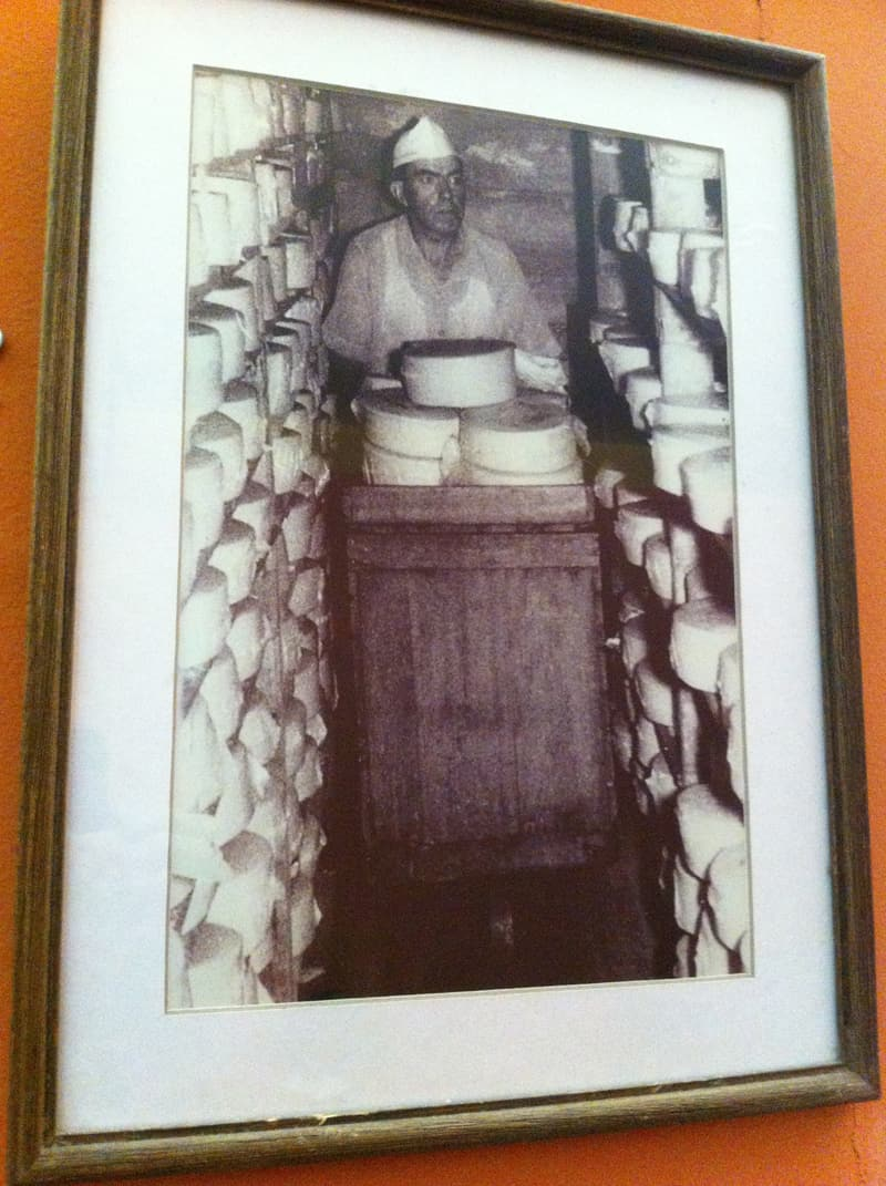 An early worker in the Monteverde Cheese Factory storage room.