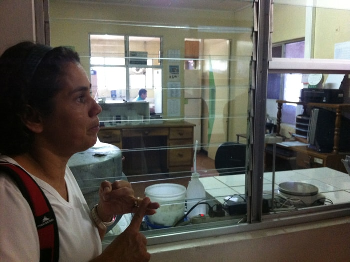 Rossy Araya, tour guide at Monteverde Cheese Room, points out the lab where milk is tested.