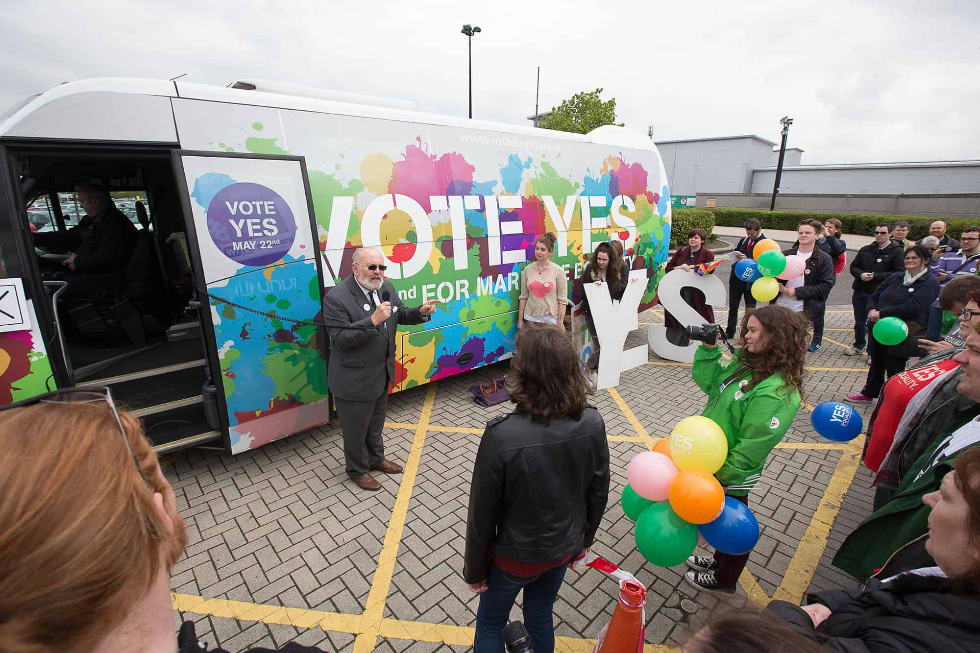 "Senator David Norris campaigns on May 14 at the ""Yes Bus"" stop at a shopping center in Dublin, Ireland."