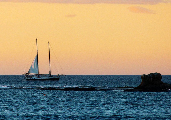 The Antares, an 80-foot schooner built in 1947, takes in a Tamarindo sunset.