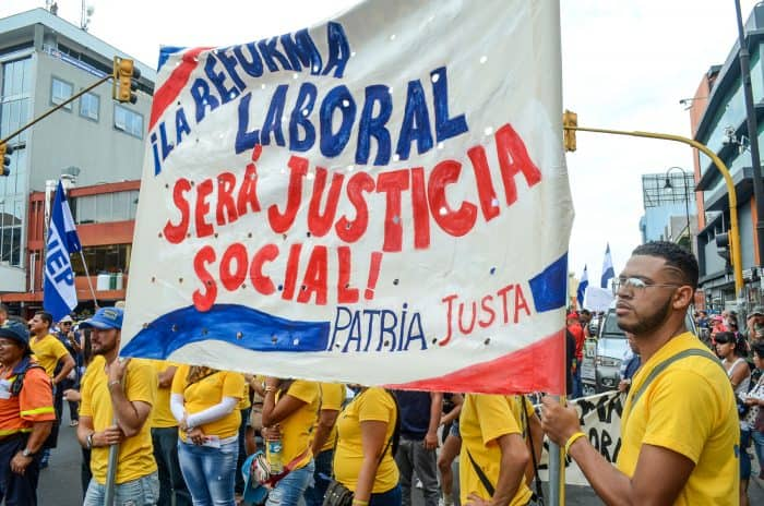 Workers from the Costa Rican Electricity Institute (ICE) support labor reform at the May 1 march.