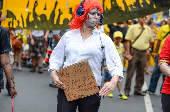 A protester criticizes working conditions at some call centers in Costa Rica.