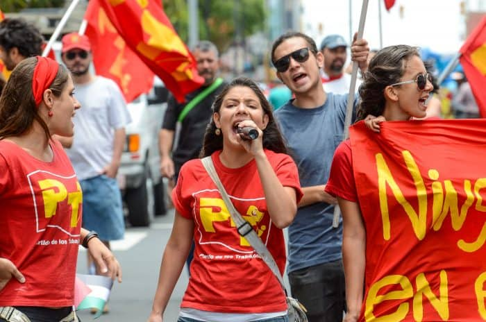 Members of the Workers Party exercise their vocal chords.
