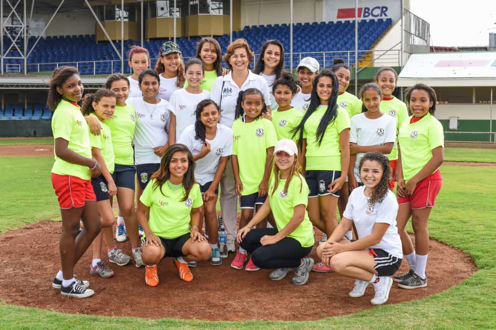 Girls taking part on the just inaugurated Women's Cricket Association pose for a photo with British ambassador Sharon Campbell (center).