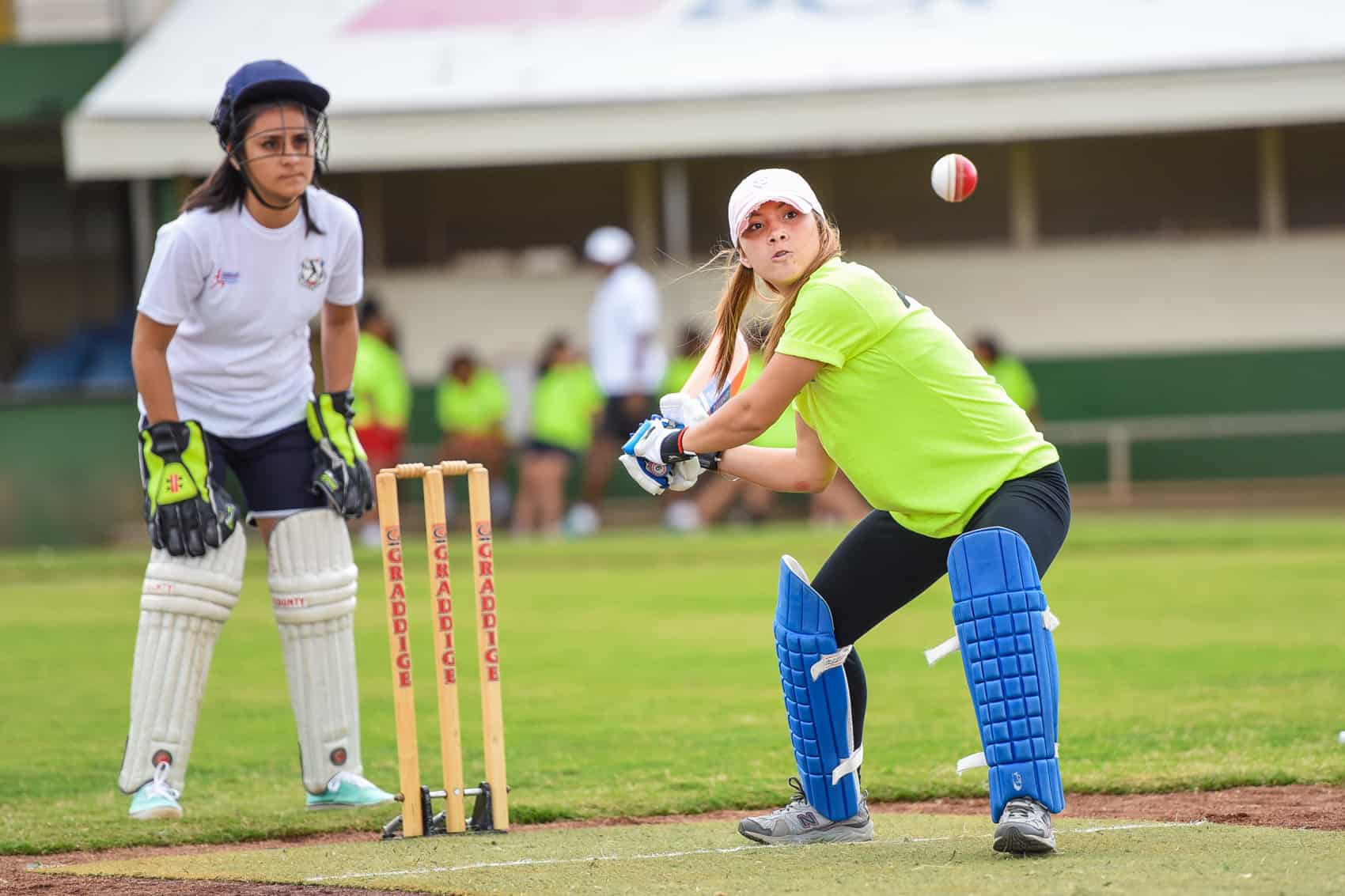 A girl bats during the inauguration of the Women's Cricket Association at the Antonio Escarré baseball stadium in San José, May 14, 2015.