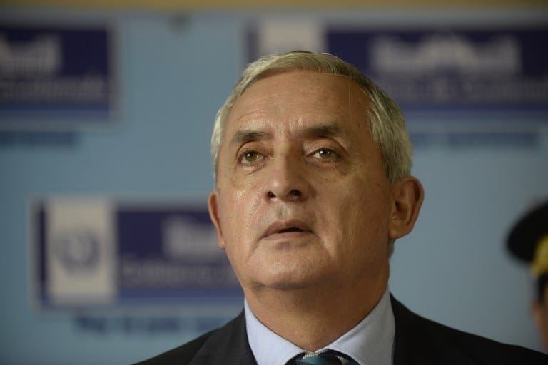 Guatemalan President Otto Perez Molina speaks during a press conference at the Interior Ministry building in Guatemala City on June 11.