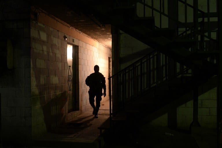 A member of the Salvadorean National Civil Police participates in an operation in search of 18th Street gang members.