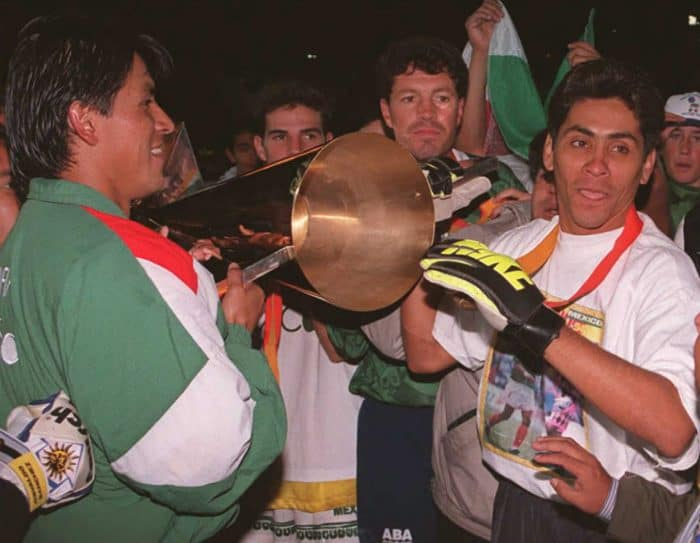 Goalkeeper Jorge Campos, right, carries the Gold Cup trophy along with teammates after Mexico defeated Brazil 2-0 in the championship match of the CONCACAF Gold Cup in 1996.