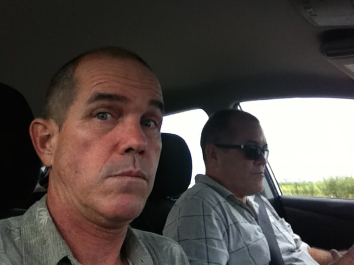Brothers in cars: Karl and Paul on the road.