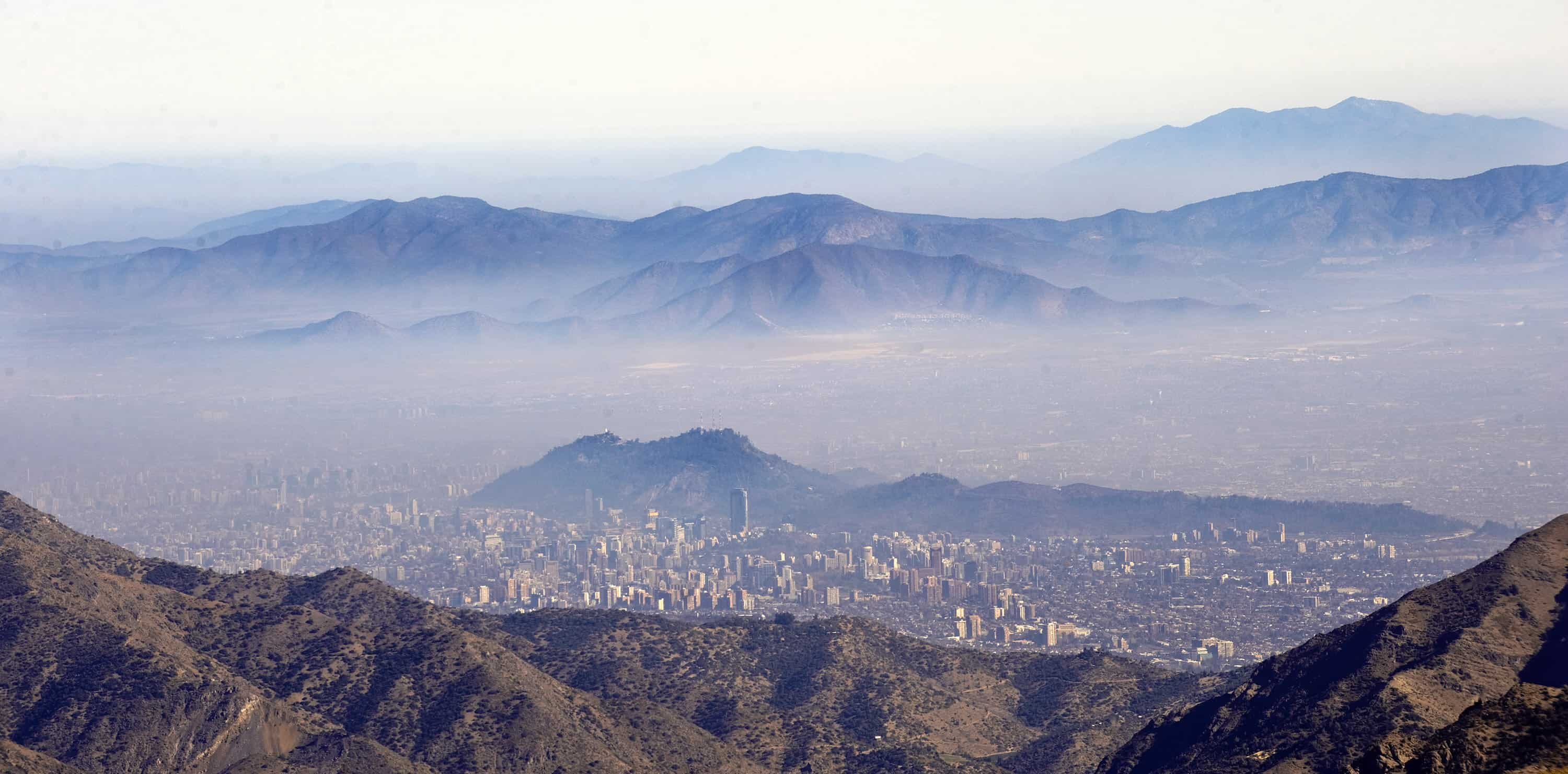 An overview of Santiago, Chile, with a layer of smog .
