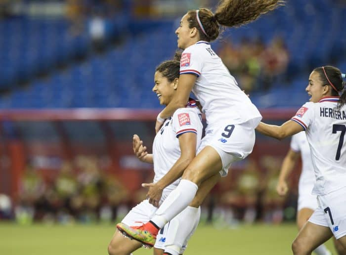 Costa Rica's Raquel Rodríguez, left, celebrates a goal against Spain with Carolina Venegas, center, and Melissa Herrera.