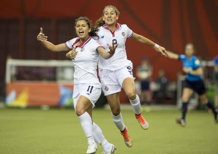 Costa Rica's Raquel Rodríguez, left, celebrates after scoring against Spain, with Carolina Venegas.