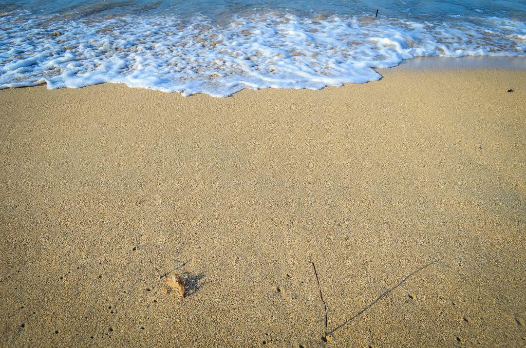 Waves folding on a beach.
