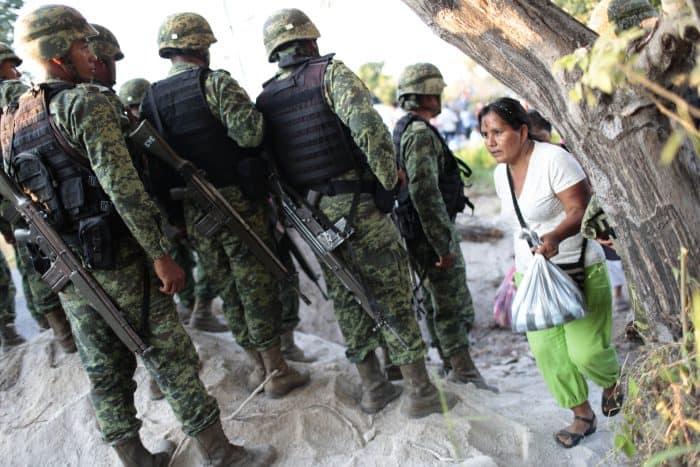 Mexican soldiers block the way during a protest of residents of Ayutla.
