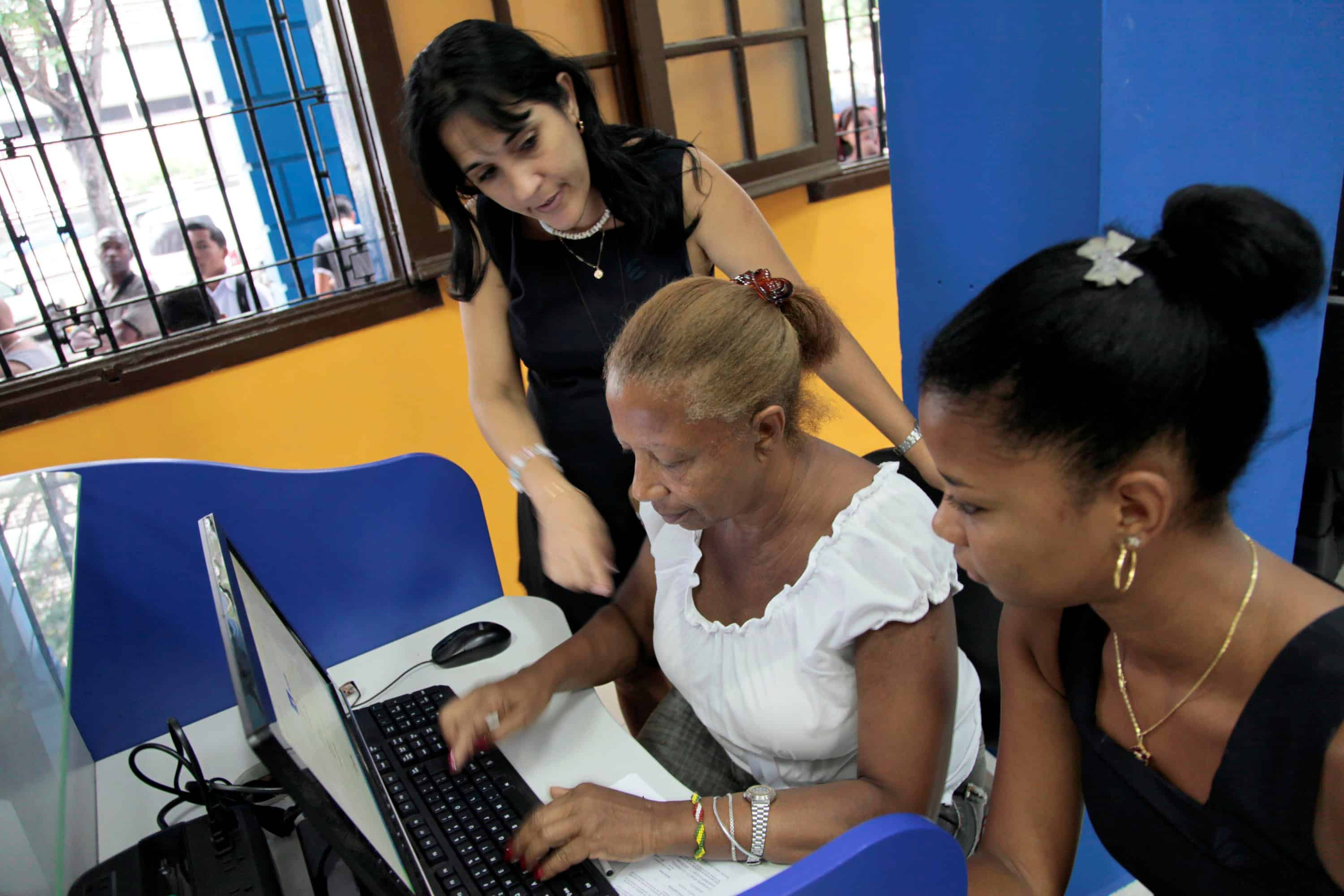 An employee of Cuban telecommunications company ETECSA helps a client.