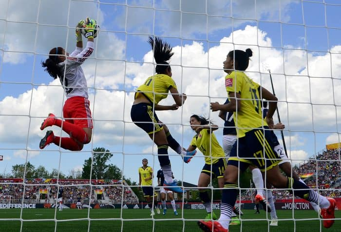 Colombia's goalkeeper Sandra Sepulveda, left, stops the ball during a Group F match.