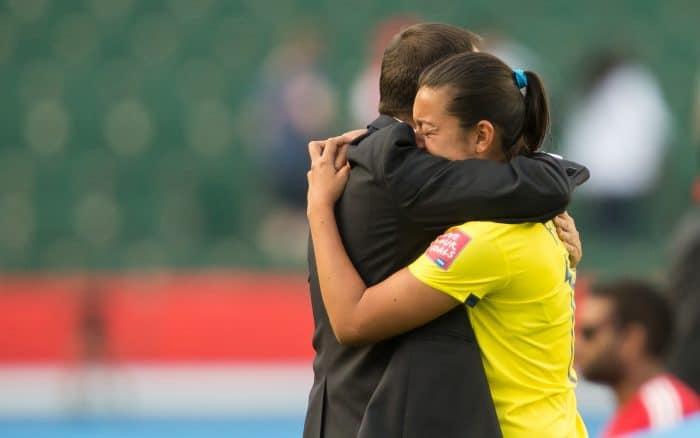 Colombian head coach Fabian Taborda consoles Yoreli Rincón.