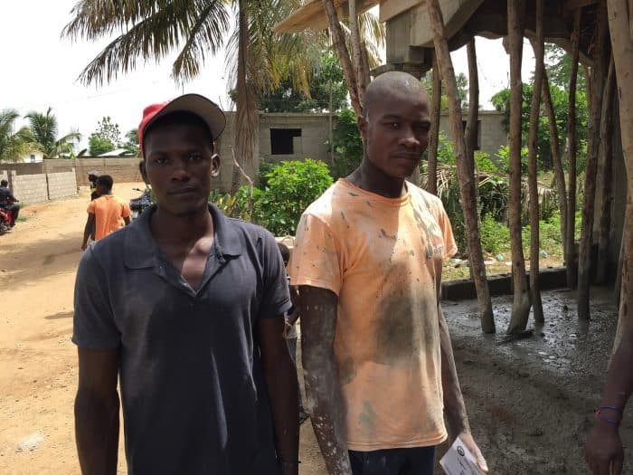 Thony Dume, 29, left, and his brother Felix Mondesir, 24, work on June 19 on the rented shack in Ouanaminthe, Haiti.