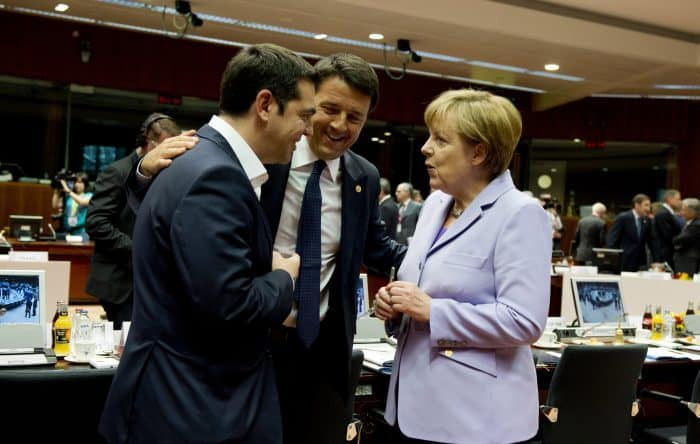 German Chancellor Angela Merkel, right, speaks with Greek Prime Minister Alexis Tsipras, left, and Italian Prime Minister Matteo Renzi.