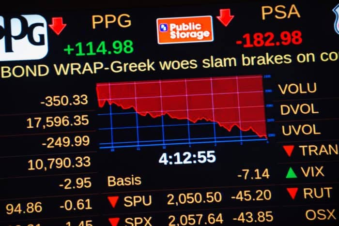 A headline about Greece's debt crisis scrolls across a stock ticker at the New York Stock Exchange.