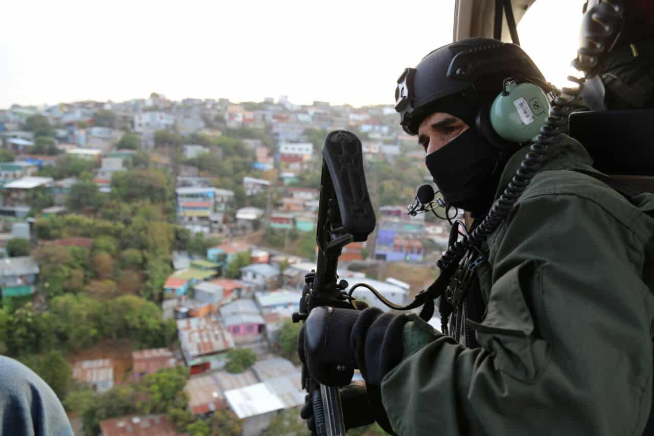 A Costa Rican police officer provides air support during a raid on April 28, 2015.
