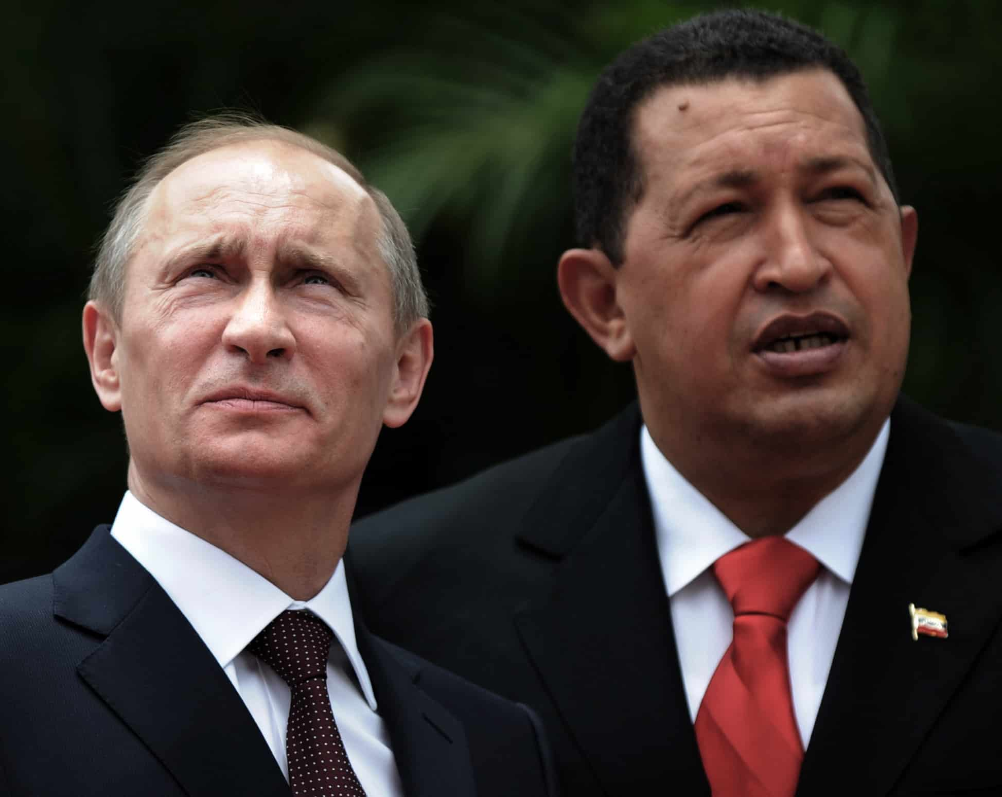 Venezuela's late President Hugo Chávez, right, speaks with Russian Prime Minister Vladimir Putin.