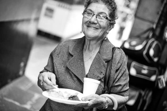Rosa Murillo enjoys a arroz con pollo.