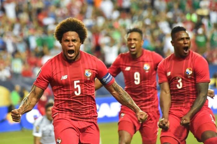 Panama's Roma Torres (L) celebrates scoring.