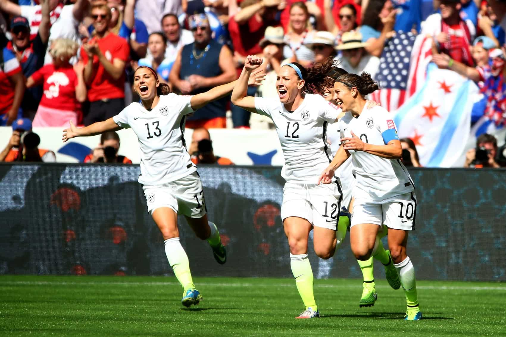 cce2de4828c Lauren Holiday  12 and Carli Lloyd  10 of the United States celebrate with  teammates