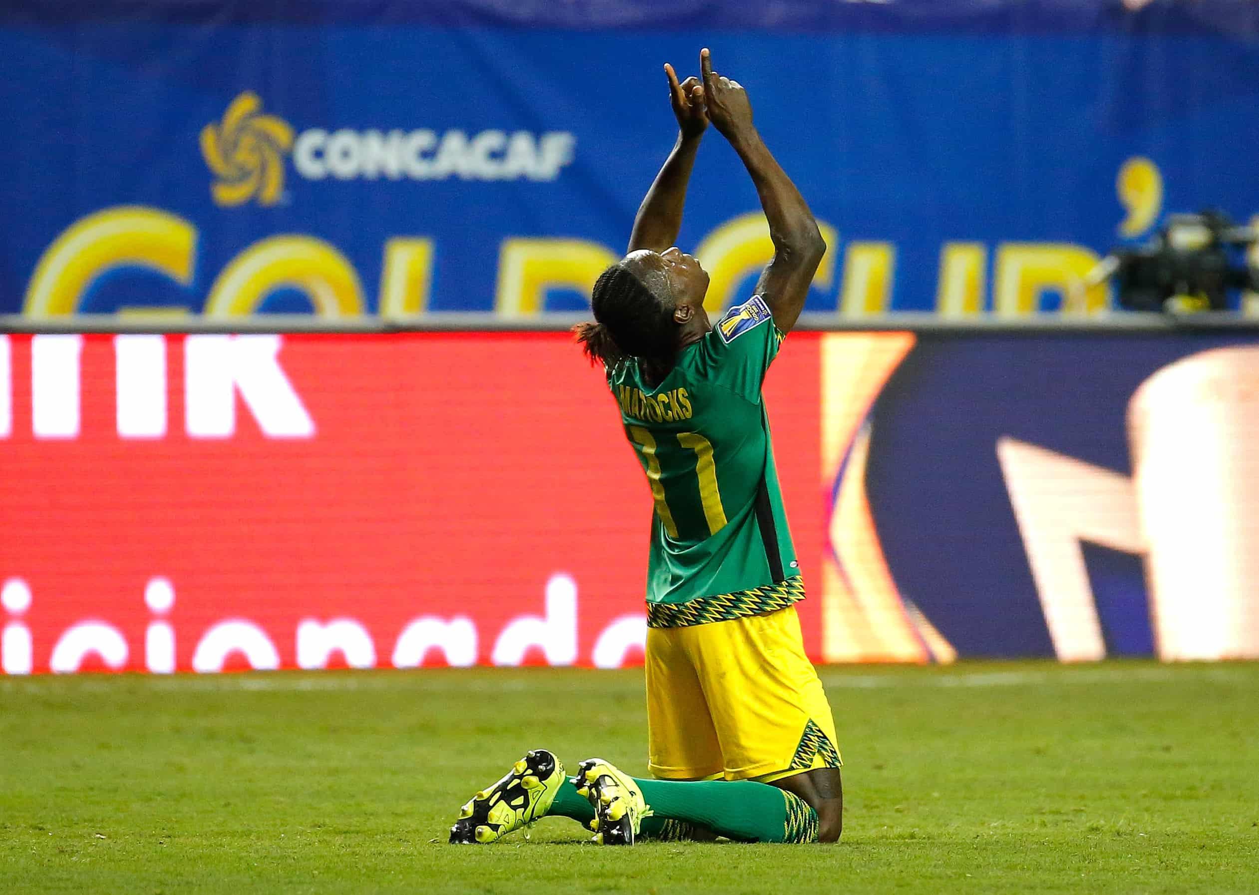 Darren Mattocks of Jamaica celebrates scoring the opening goal against the United States.