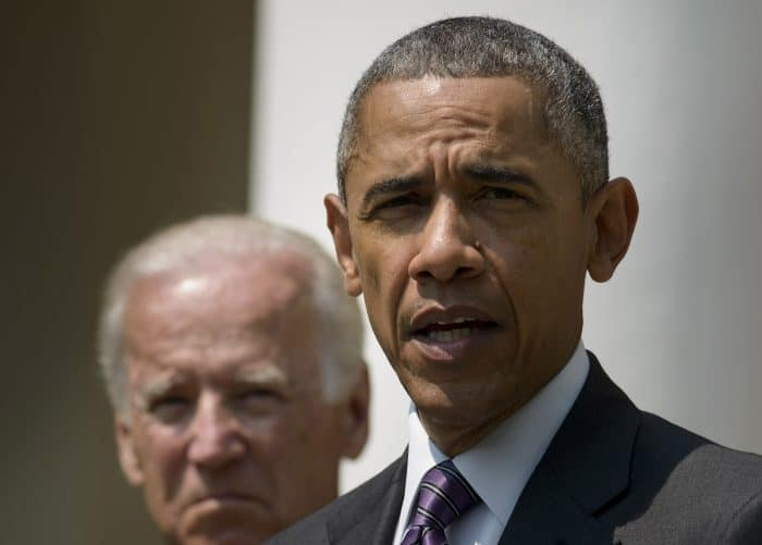 U.S. Vice President Joe Biden listens while President Barack Obama speaks in the Rose Garden.