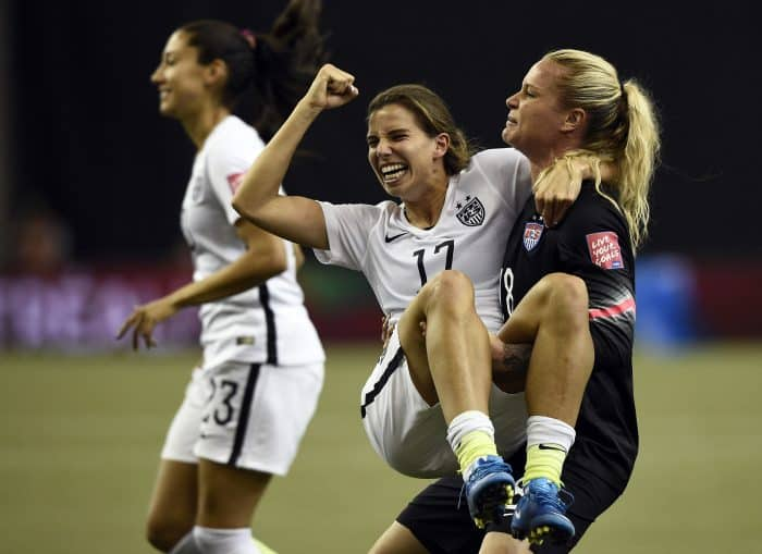 U.S. midfielder Tobin Heath, left, and goalkeeper Ashlyn Harris.
